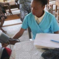 Newly Hired Nurse Monitoring Blood Pressure